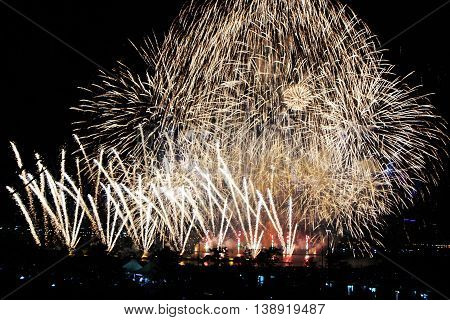 Beautiful fireworks on the city. International Fireworks. Fireworks display on dark sky background.