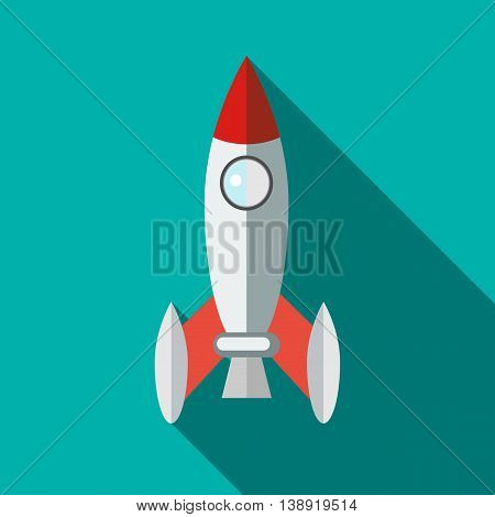 Retro rocket icon in flat style on a turquoise background