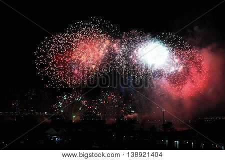 Beautiful fireworks on sky. International Fireworks. Fireworks display on dark sky background.