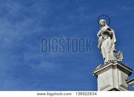 Statue of John the Evangelist and Apostle from baroque facade o Santa Maria Assunta jesuit church in Venice (18th century)