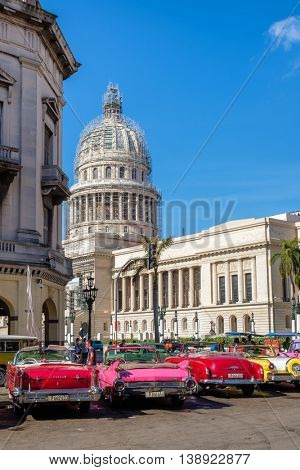 HAVANA,CUBA - JULY 14,2016 :  Group of colorful old classic cars near the Capitol in Old Havana
