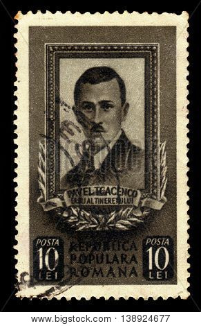 ROMANIA - CIRCA 1951: A stamp printed in Romania shows portrait of Pavel Tcacenco or Tkachenko, russian-born romanian communist activist, a leading member of the communist movements of Bessarabia and Romania, circa 1951