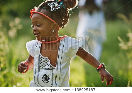 African baby girl walking and run at park