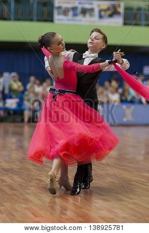 Minsk Belarus -May 28 2016: Novikov Yaroslav and Murza Alina Perform Juvenile-1 Standard European Program on National Championship of the Republic of Belarus in May 28 2016 in Minsk Republic of Belarus