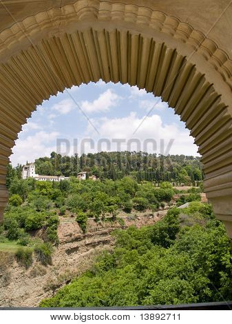 view over generalife gardens though arch