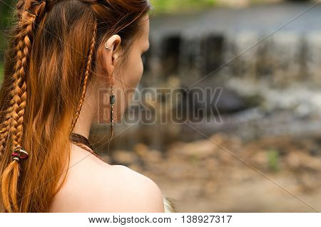 braid hairstyle on redhead woman close up