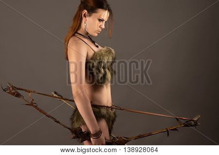 woman archer with bow isolated on gray