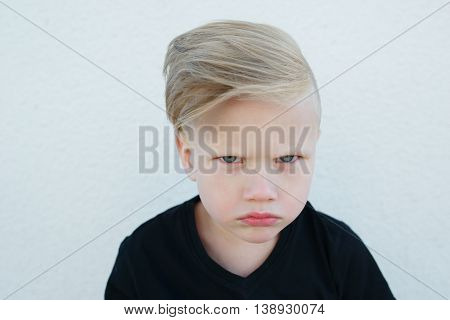 photo of young emotional boy on bright background