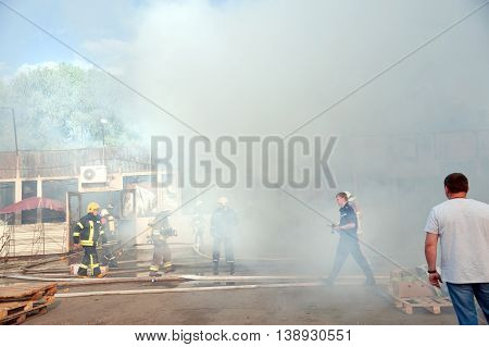 Kiev Ukraine - June 16 2016: Firefighters extinguish a large fire at Troyeschina market.