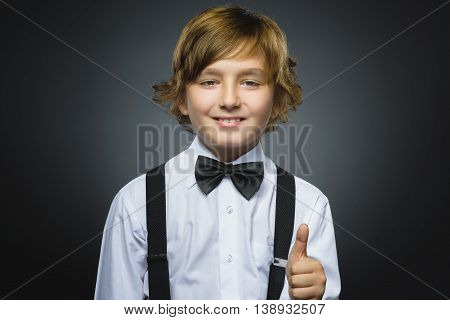 Closeup portrait successful happy boy isolated grey background. Positive human emotion face expression. Life perception achievement vision.