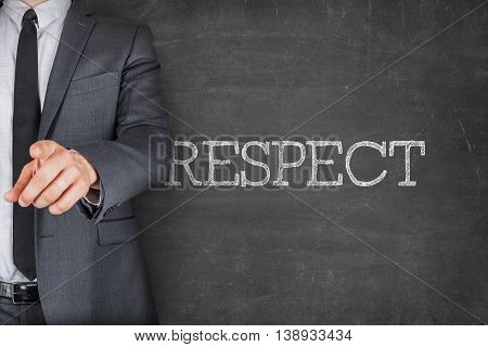 Concept on blackboard with businessman finger pointing