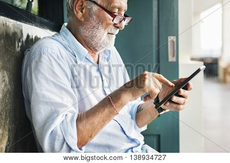 Old Man Using Telephone Online Concept
