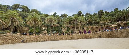 BARCELONA SPAIN - JULY 3 2016: Panoramic view of Park Guell. Park Guell is the famous architectural town art designed by Antoni Gaudi and is popular with tourists.