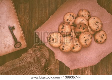 Homemade chocolate chip cookies on rustic wooden table top view