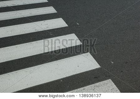Pedestrian crossing on the road photographed on the diagonal.