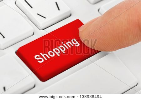 Computer notebook keyboard with Shopping key - technology background