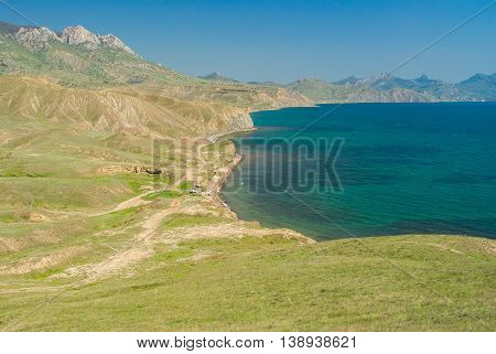 Crimean spring landscape near Karadag volcanic mountain range on a Black Sea shore Crimean peninsula