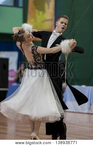 Minsk Belarus -May 28 2016: Ermolovich Konstantin and Snegir Anna Perform Youth-2 Standard Program on National Championship of the Republic of Belarus in May 28 2016 in Minsk Belarus
