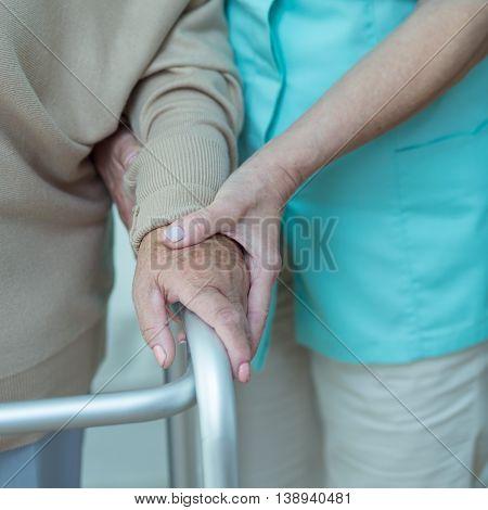 Woman Using Walking Frame