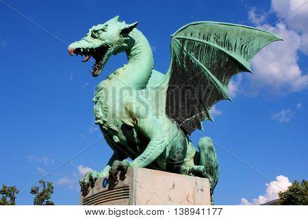 Large green Dragon bridge statue in Ljubljana Slovenia