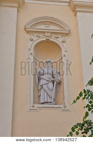 VALTICE CZECH REPUBLIC - MAY 29 2016: Statue of Saint Paul the Apostle on the facade of Church of the Annunciation of the Virgin Mary (circa 17th c.) in Valtice Czech Republic. UNESCO site
