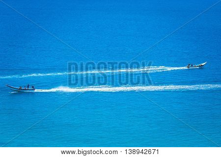 Two boats in the crystal clear azure ocean