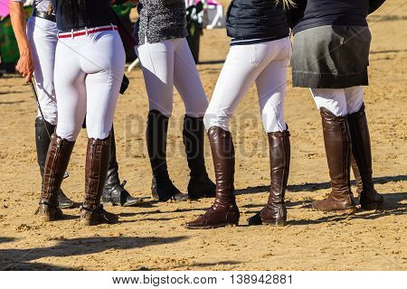 Riders unidentified boots gear man women on equestrian arena