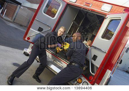 Paramedics preparing to unload patient from ambulance