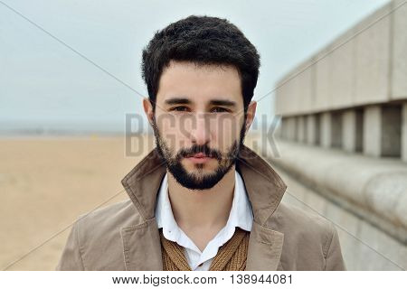 Handsome Groom In Coat In The Nature. Male Portrait In The Park. Beautiful Model Boy In Colorful Wed
