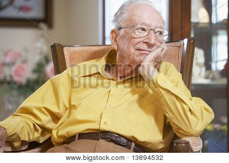 Senior man relaxing in armchair