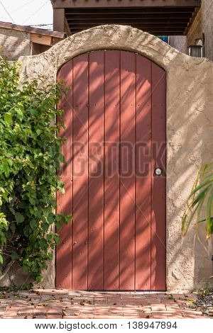 Round Top Closed Plank Gate In Gate With Arch
