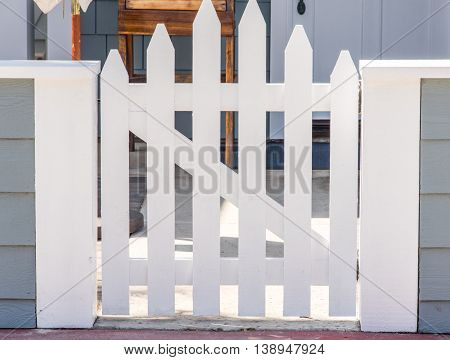 Nice New White Closed Fence Gate With Z-frame And Convex Shape