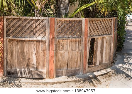 Natural Wood Privacy Fence With Diagonal Board On Board Picket Top