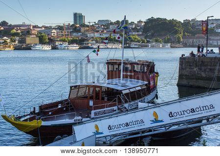 PORTO, PORTUGAL - JUL 14, 2016: Tourist boats on the Douro river at Ribeira, historical center of Porto. City of Porto won the European Best Destination 2012 and 2014 awards.