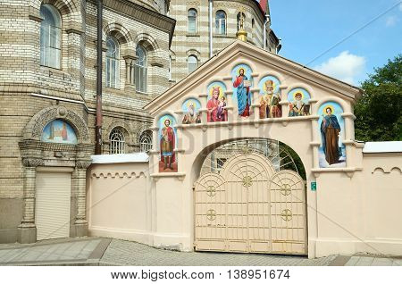 The gate to the yard of the Church.They painted the faces of Christian saints.