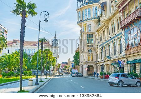 BATUMI GEORGIA - MAY 26 2016: The central city streets with the luxury mansions and green palms on May 26 in Batumi.