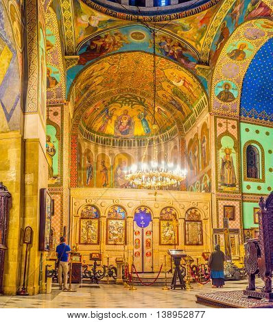 TBILISI GEORGIA - MAY 28 2016: The richly decorated prayer hall of Sioni Cathedral of Dormition with beautiful frescoes on May 28 in Tbilisi.