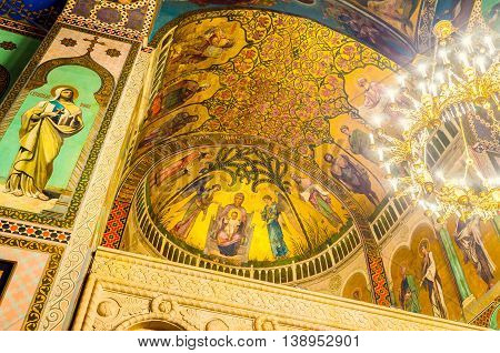 TBILISI GEORGIA - MAY 28 2016: The cupola of Sioni Cathedral of Dormition covered with beautiful frescoes on the gilt background on May 28 in Tbilisi.