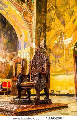 TBILISI GEORGIA - MAY 28 2016: The throne for the Georgian patriarch decorated with carved grifons and patterns stands in Sioni Cathedral of Dormition on May 28 in Tbilisi.