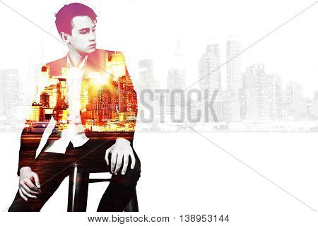 Thoughtful young businessman on city background with copy space. Double exposure