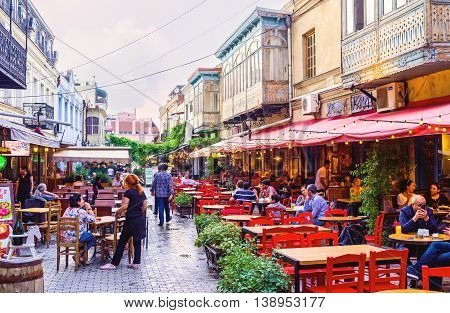 TBILISI GEORGIA - MAY 28 2016: The local restaurant offers the nice summer terrace the best place for the supper on the fresh air on May 28 in Tbilisi.