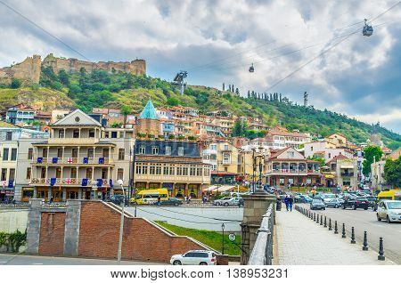TBILISI GEORGIA - MAY 28 2016: The grey clouds over Vakhtang Gorgasali Square and Sololaki hill on May 28 in Tbilisi.