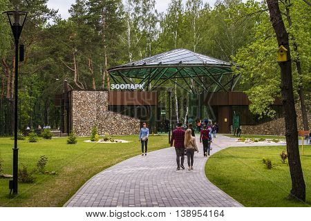 RUSSIA, BELGOROD - JUNE 13 2016: New Belgorod zoo in the woods. Walkway in front of the entrance.