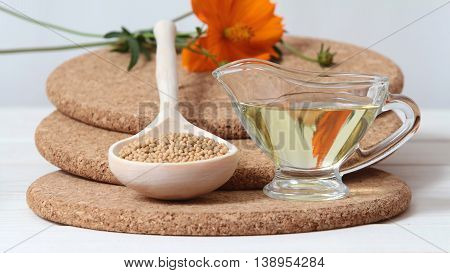 Whole mustard seeds and mustard oil (vegetable, refined)