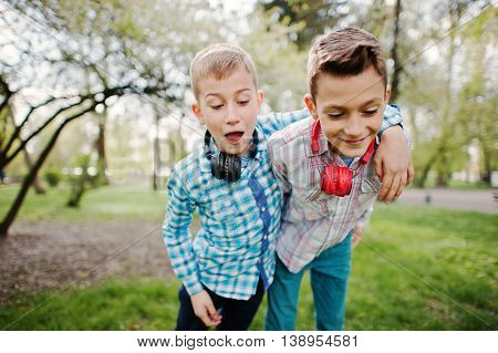 Two Brother Boy With Headphones Having Fun On Park. Brother Love.