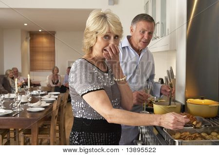 Couple Having Difficulty Cooking For A Dinner Party