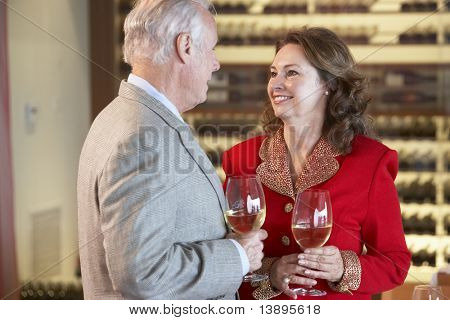 Couple Enjoying A Drink At A Bar Together