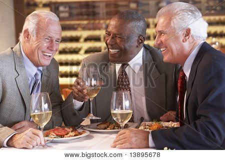 Friends Having Dinner Together At A Restaurant