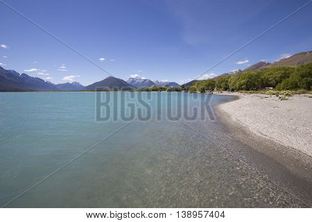 The Dart River, Glenorchy, flows through rugged forested country in the southwestern South Island of New Zealand