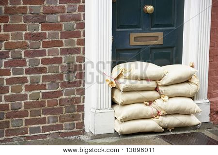 Sandbags Stacked In A Doorway In Preparation For Flooding